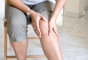 Woman suffering from varicose vein pain